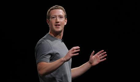 File-This Feb. 21, 2016, file photo sshows Facebook CEO Mark Zuckerberg speaking during the Samsung Galaxy Unpacked 2016 event in Barcelona, Spain. Some of Zuckerberg's neighbors are grumbling about a rock wall he's having built on his property on Kauai's north shore. Retiree Moku Crain said Tuesday, June 28, 2016, the wall looks daunting and forbidding. Crain hopes and expects Zuckerberg will soften the wall's look by planting foliage around it. The wall began going up about four to six weeks ago. It runs along the property next to a road in the semi-rural community of Kilauea. (ANSA/AP Photo/Manu Fernadez, File)