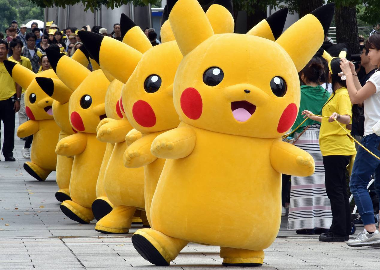 "Dozens of Pikachu characters, the famous character of Nintendo's videogame software Pokemon, march at the Landmark Plaza shopping mall in Yokohama, suburban Tokyo on August 13, 2015.  The Pikachu mascots walk around daily to attract summer vacationers as a part of the ""Pikachu Outbreak"" event through the weekend.     AFP PHOTO / Yoshikazu TSUNO"