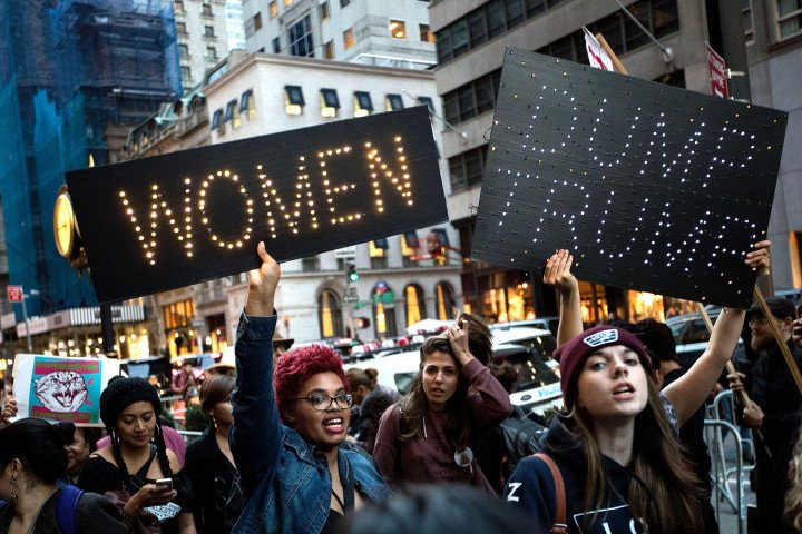 A group of protestors, comprised mostly of women, rally against Republican presidential candidate Donald Trump outside of Trump Tower, November 3, 2016 in New York City.