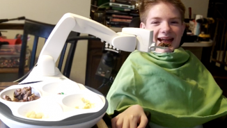 Boy-using-Obi-robotic-feeding-device