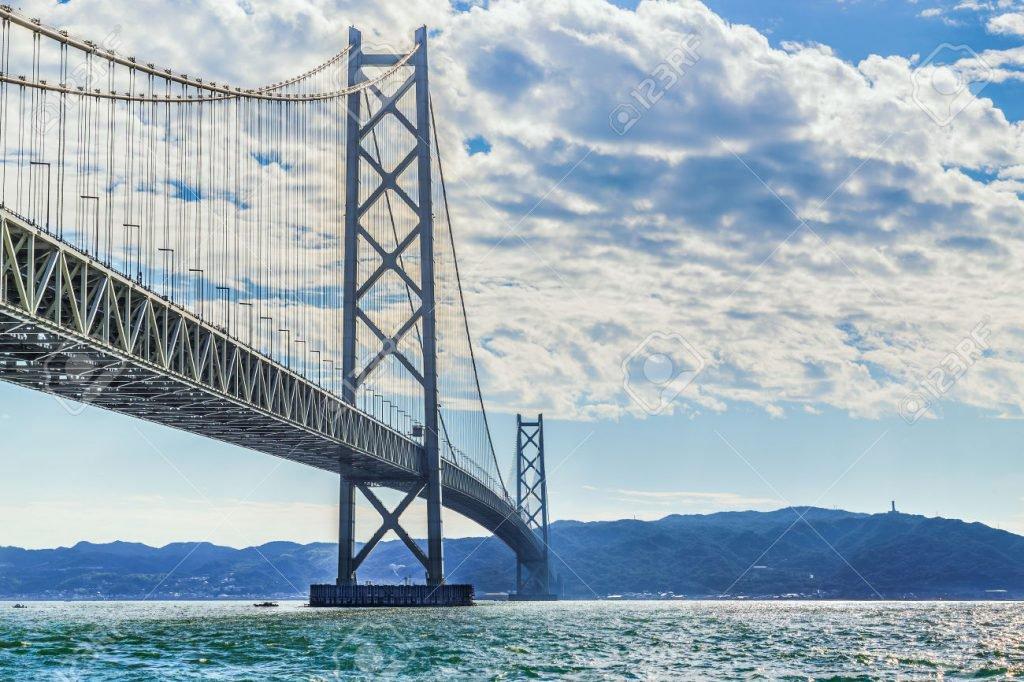 Akashi-Kaikyo Bridge in Kobe, Japan KOBE, JAPAN - OCTOBER 25: Akashi-Kaikyo Bridge in Kobe, Japan on October 25, 2014. Links Kobe mainland to Iwaya on Awaji Island, the bridge has the longest central span of any suspension bridge in the world