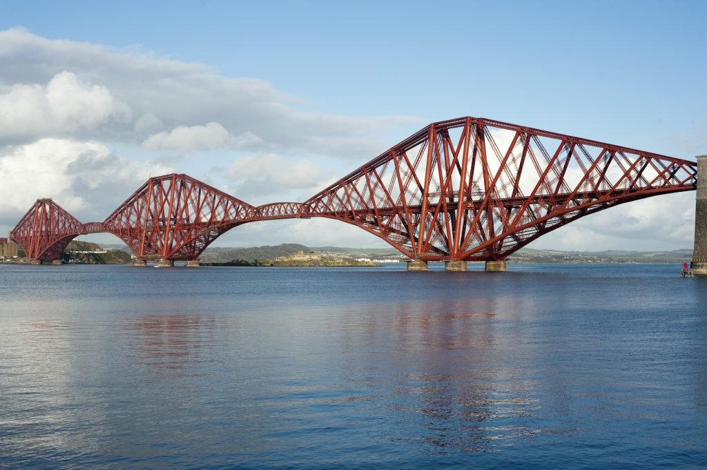 a sunny day view of the massive piers of the forth bridge and spans between