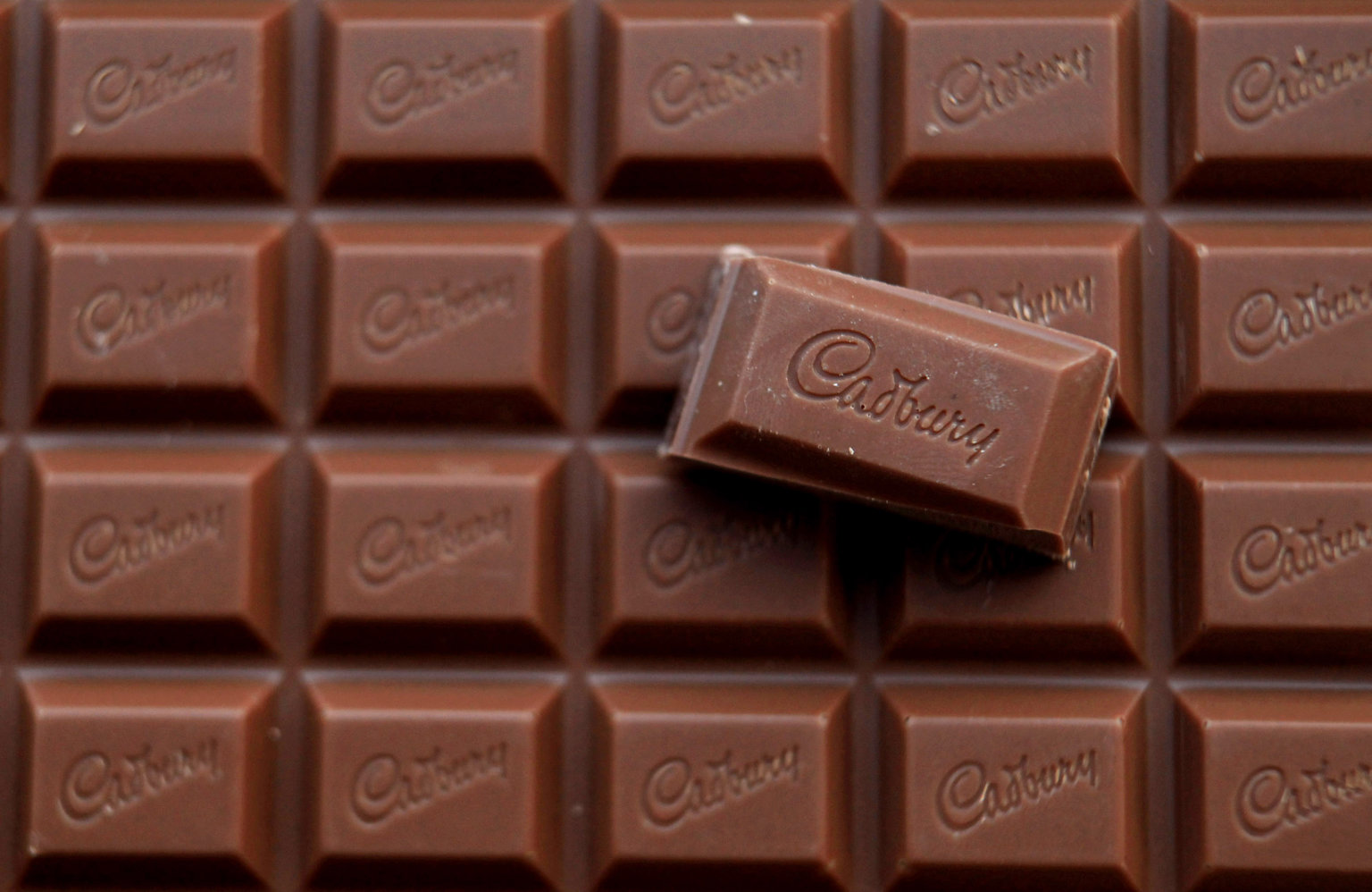 BRISTOL, ENGLAND - JANUARY 19: In this photograph illustration a bar of Cadbury's Dairy Milk chocolate is seen on January 19, 2010 in Bristol, England. The US food giant Kraft has today agreed a takeover of Dairy Milk maker Cadbury in a deal worth 11 billion GBP, however many Cadbury workers remained concerned over the longterm future of their jobs. (Photo by Matt Cardy/Getty Images)