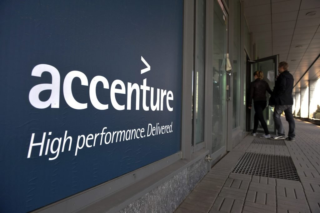 People enter an Accenture office in downtown Helsinki on April 27, 2011. The world's leading mobile phone maker Nokia said on April 27 it would cut 4,000 jobs worldwide by the end of 2012 and transfer a further 3,000 employees to consulting firm Accenture. Nokia said it would outsource to Accenture the activities of its Symbian smartphone platform, including 3,000 employees, by the end of this year. AFP PHOTO / LEHTIKUVA / Jussi Nukari *** FINLAND OUT *** (Photo credit should read JUSSI NUKARI/AFP/Getty Images)