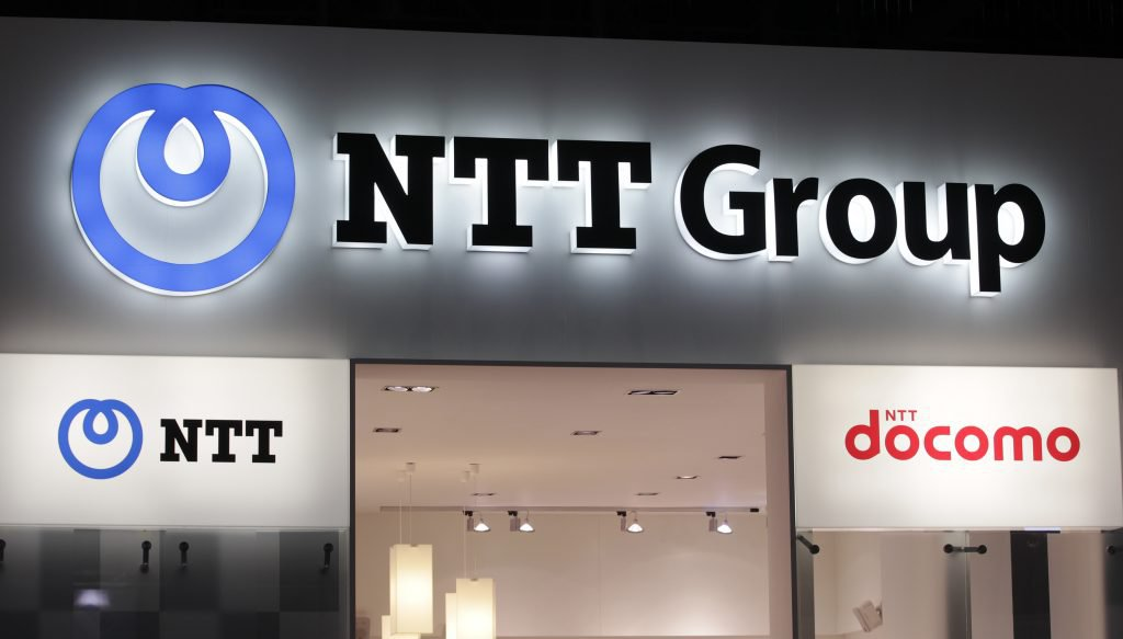The logo for NTT Docomo, one of Japan's largest providers of mobile voice, data and multimedia services, is pictured at the ITU Telecom World in Geneva October 24, 2011. ITU Telecom World 2011 is a gathering of government and industry leaders which will focus on applying connected technology to real-world issues. The event will run from October 24 to October 27. REUTERS/Denis Balibouse (SWITZERLAND - Tags: BUSINESS TELECOMS) - RTR2T4VB