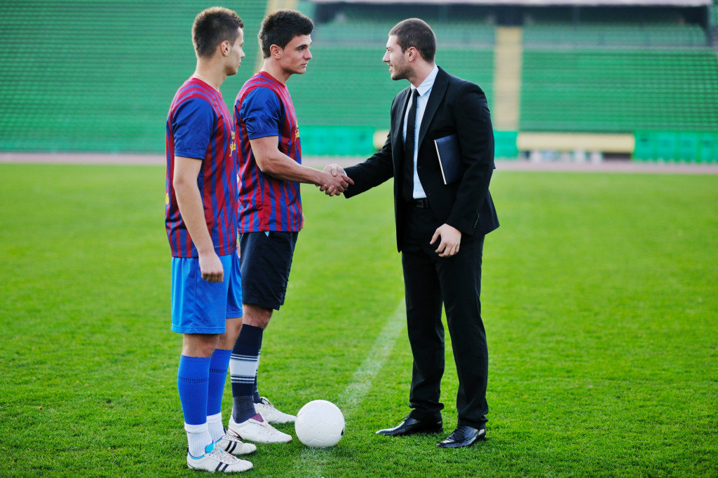soccer sport manager in business suit coach and football player
