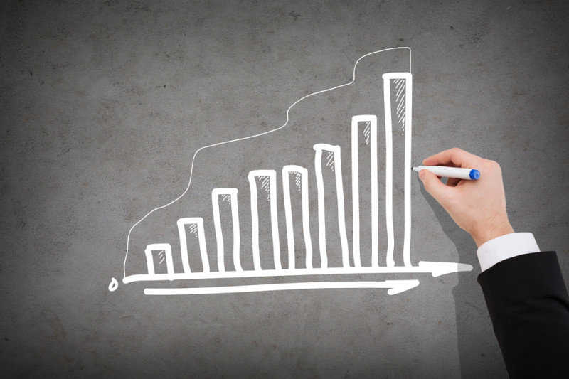 close up of businessman drawing growing graph