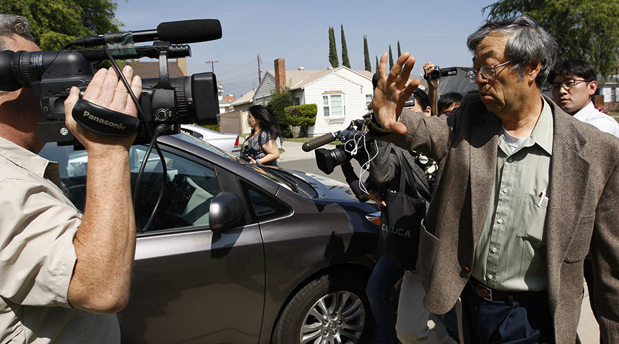 A man widely believed to be Bitcoin currency founder Satoshi Nakamoto, also known as Dorian Nakamoto, is surrounded by reporters as he leaves his home in Temple City, California