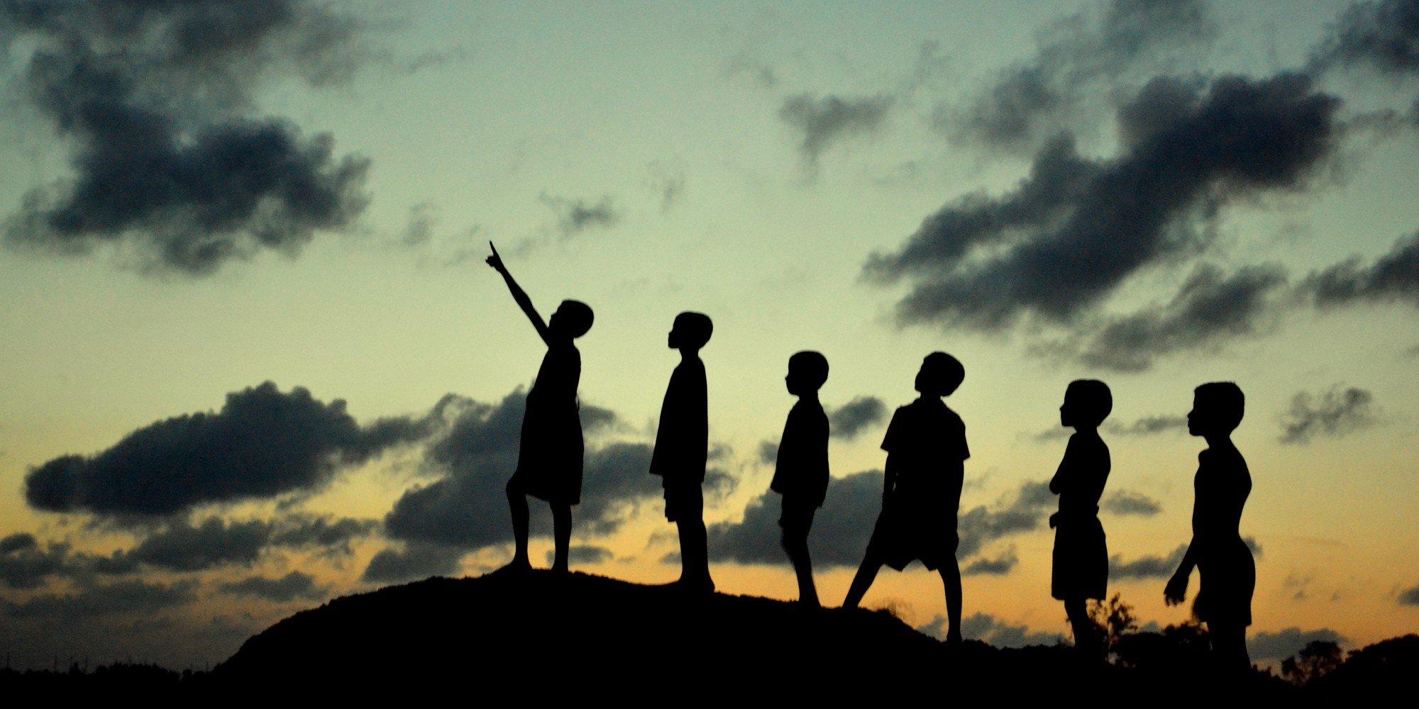 Children watching monsoon cloud formation