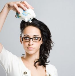 brunette-girl-empty-piggy-bank