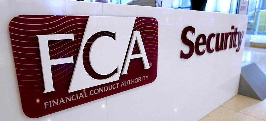 A logo sits on a sign in the reception area of the Financial Conduct Authority (FCA) in the Canary Wharf business district in London, U.K., on Thursday. Nov. 21, 2013. The FCA is working with regulators including the U.S. Department of Justice and the Commodity Futures Trading Commission to investigate the potential manipulation of the foreign-exchange market. Photographer: Chris Ratcliffe/Bloomberg