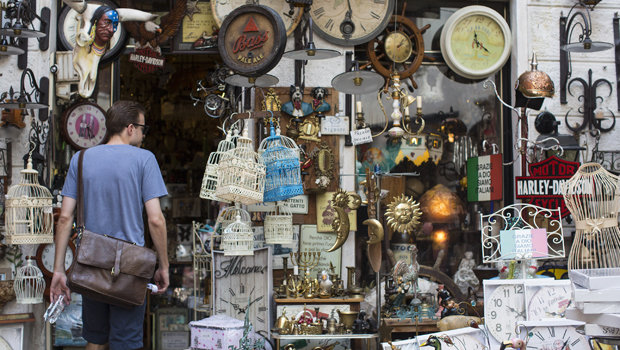 MALCESINE, ITALY - JULY 12: (EDITORIAL USE ONLY) In this handout image provided by Red Bull, a man walks into an antiques and collectables shop prior to the fourth stop of the Red Bull Cliff Diving World Series on July 12, 2013 at Malcesine, Italy. (Photo by Romina Amato/Red Bull via Getty Images)