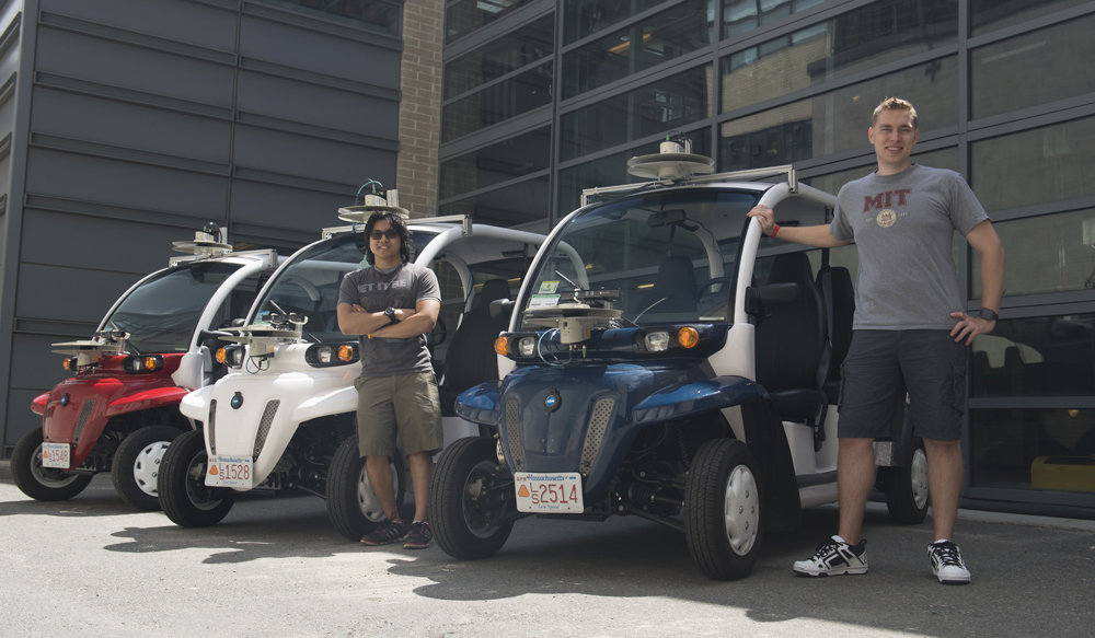 """Graduate student Justin Miller and undergrad Wally Wibowo of the Aerospace Controls Lab working on vehicles outfitted with sensors that match those of self-driving cars. This work is part of the Ford-MIT Alliance and aims to predict pedestrian behaviors on short time-scales while also providing data to support a mobility-on-demand system for the MIT campus."""""""