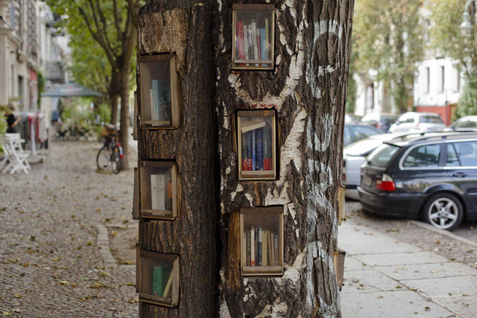 This Tuesday, Oct. 4, 2011 photo shows books in boxes inside the Book Tree, also known as Buecherwald, at Prenzlauer Berg's Sredzkistrasse in Germany's capital Berlin. Take a book, leave a book. In the birthplace of the printing press, public bookshelves are popping up across the nation on street corners, city squares and suburban supermarkets. In these free-for-all libraries, people can grab whatever they want to read, and leave behind anything they want for others. There's no need to register, no due date, and you can take or give as many as you want.(AP Photo/Markus Schreiber)