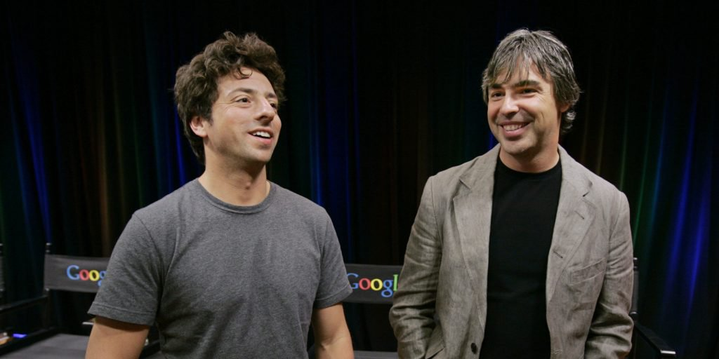 FILE - In this Sept. 2, 2008 file photo, Google co-founders Sergey Brin, left, and Larry Page talk during a new conference at Google Inc. headquarters in Mountain View, Calif. Google has settled a shareholder lawsuit to clear the way for a long-delayed split of the Internet search leader's stock. The agreement announced Monday, June 17, 2013, resolves allegations that Google co-founders Page and Brin engineered the stock split in a way that unfairly benefits them and shortchanges the rest of the company's shareholders. (AP Photo/Paul Sakuma, File)